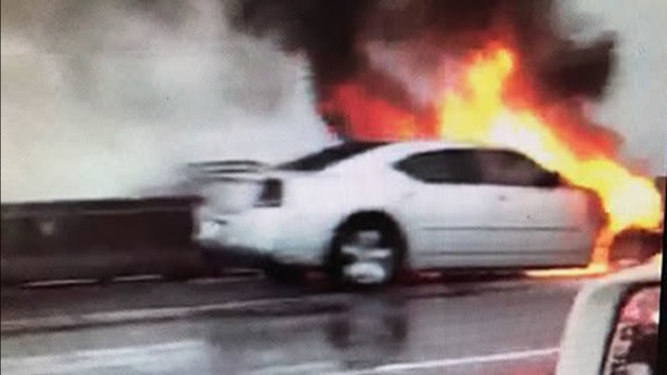 A car fire closed several lanes of Highway 92 on the San Mateo Bridge on Monday, Jan. 8, 2018.