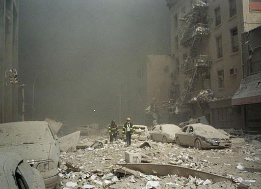 <div class='meta'><div class='origin-logo' data-origin='none'></div><span class='caption-text' data-credit='AP Photo/ RICHARD COHEN'>FIremen walk through a dust and debris covered street in lower Manhattan Tuesday, Sept. 11, 2001.</span></div>