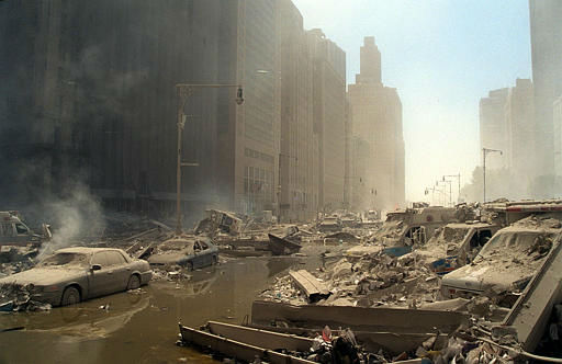 "<div class=""meta image-caption""><div class=""origin-logo origin-image none""><span>none</span></div><span class=""caption-text"">Rubble and ash fill lower Manhattan streets after two hijacked airliners were crashed into the towers of the World Trade Center in  New York, Tuesday, Sept. 11, 2001. (AP Photo/ BOUDICON ONE)</span></div>"