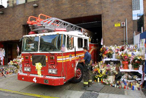 <div class='meta'><div class='origin-logo' data-origin='none'></div><span class='caption-text' data-credit='AP Photo/ STUART RAMSON'>Ladder 4 truck is surrounded by makeshift memorials as it returns to its midtown New York firehouse after a call Tuesday, Sept. 18, 2001.</span></div>