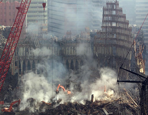 <div class='meta'><div class='origin-logo' data-origin='none'></div><span class='caption-text' data-credit='AP Photo/ MICHAEL CONROY'>Work continued on the site of the World Trade Center as steam rises from the rubble in New York, Thursday, Oct. 11, 2001.</span></div>