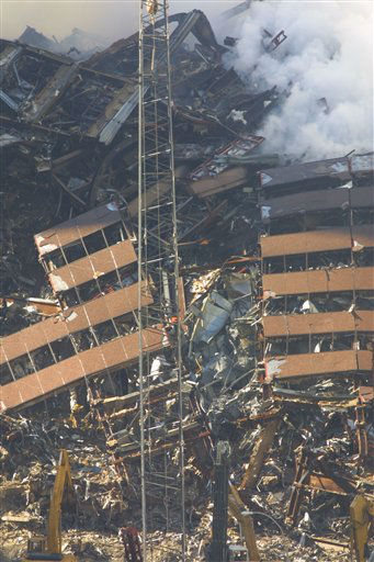 <div class='meta'><div class='origin-logo' data-origin='none'></div><span class='caption-text' data-credit='Photo/Wally Santana'>Construction workers continue to clear the rubble at the site of the World Trade Center, destroyed in the September 11, 2001 terrorist attacks, on September 15, 2001.</span></div>