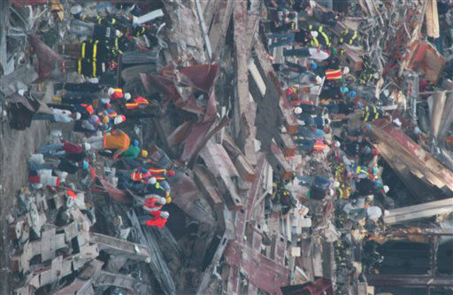 <div class='meta'><div class='origin-logo' data-origin='none'></div><span class='caption-text' data-credit='AP Photo/ Chad Rachman'>Construction workers continue to clear the rubble at the site of the World Trade Center, destroyed in the September 11, 2001 terrorist attacks, on September 15, 2001.</span></div>