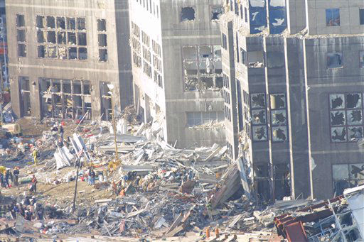 <div class='meta'><div class='origin-logo' data-origin='none'></div><span class='caption-text' data-credit='AP Photo/ Wally Santana'>Workers clean up rubble on September 15, 2001 at ground zero after the September 11, 2001 attacks in New York City</span></div>