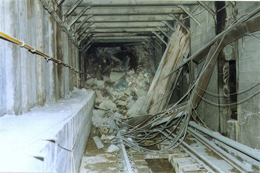 <div class='meta'><div class='origin-logo' data-origin='none'></div><span class='caption-text' data-credit='AP Photo/ Anonymous'>Steel I-beams and rubble cover the tracks of the #1 and #9 subway lines in a tunnel under the World Trade Center.</span></div>