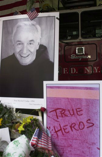 <div class='meta'><div class='origin-logo' data-origin='none'></div><span class='caption-text' data-credit='Photo/Charlie Krupa'>A large portrait of Father Mychael Judge, the FDNY chaplain who died in the World Trade Center collapse, is part of the memorial to firemen at Ladder 24, Engine 1</span></div>