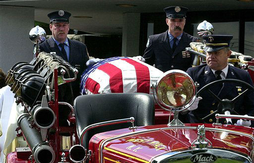 <div class='meta'><div class='origin-logo' data-origin='none'></div><span class='caption-text' data-credit='AP Photo/ PETER CARR'>The casket for New York City firefighter Thomas Foley of West Nyack, N.Y., is carried from St. Anthony's Church in Nanuet, N.Y., to St. Anthony's cemetery.</span></div>