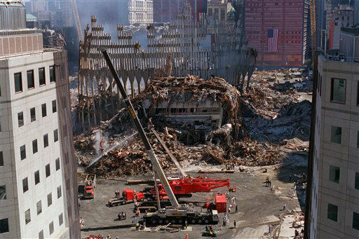 <div class='meta'><div class='origin-logo' data-origin='none'></div><span class='caption-text' data-credit='AP Photo/ QUYEN TRAN'>Two large cranes are positioned near the rubble of the World Trade Center in New York, on Wednesday, Sept. 26, 2001.</span></div>