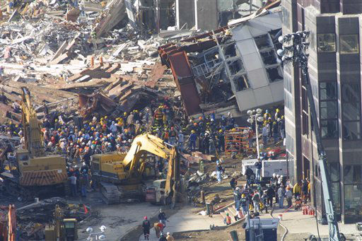 "<div class=""meta image-caption""><div class=""origin-logo origin-image none""><span>none</span></div><span class=""caption-text"">Construction workers and firemen continue to clear the rubble at the site of the World Trade Center, destroyed in the September 11, 2001 terrorist attacks, on September 15, 2001. (AP Photo/ Wally Santana)</span></div>"