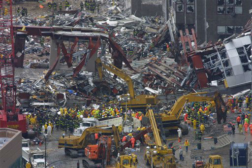 <div class='meta'><div class='origin-logo' data-origin='none'></div><span class='caption-text' data-credit='AP Photo/ Shawn Baldwin'>Construction workers and firemen continue to clear the rubble at the site of the World Trade Center, destroyed in the September 11, 2001 terrorist attacks, on September 14, 2001.</span></div>