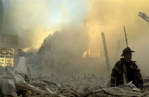 <div class='meta'><div class='origin-logo' data-origin='none'></div><span class='caption-text' data-credit='AP Photo/ GRAHAM MORRISON'>A lone firefighter moves through piles of debris at the site of the World Trade Center in New York, Tuesday, Sept. 11, 2001</span></div>