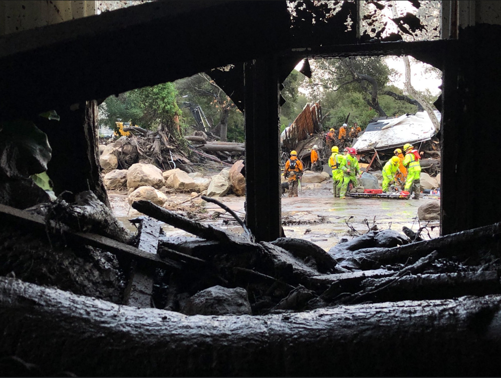 "<div class=""meta image-caption""><div class=""origin-logo origin-image none""><span>none</span></div><span class=""caption-text"">""Scene from the 300 block of Hot Springs Road in Montecito following debris and mud flow due to heavy rain."" (EliasonMike/Twitter)</span></div>"