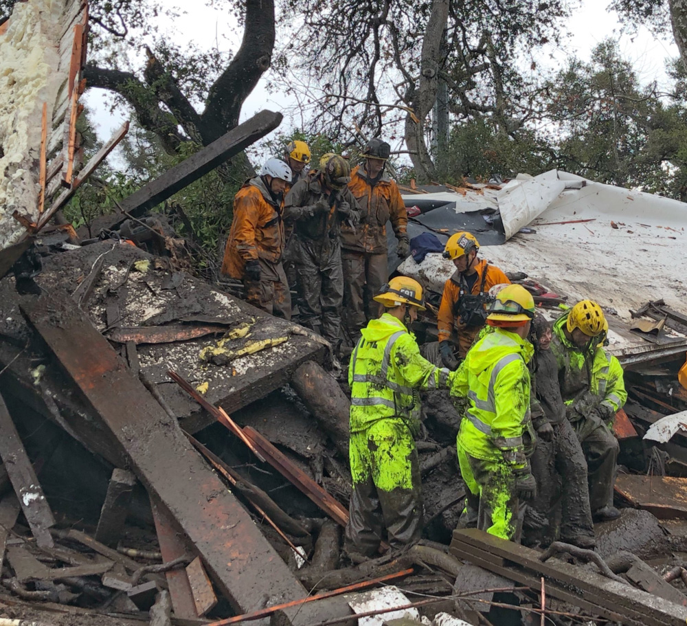 <div class='meta'><div class='origin-logo' data-origin='none'></div><span class='caption-text' data-credit='EliasonMike/Twitter'>&#34;Firefighters successfully rescued a 14 yr old girl (right) after she was trapped for hours inside a destroyed home in Montecito.&#34;</span></div>