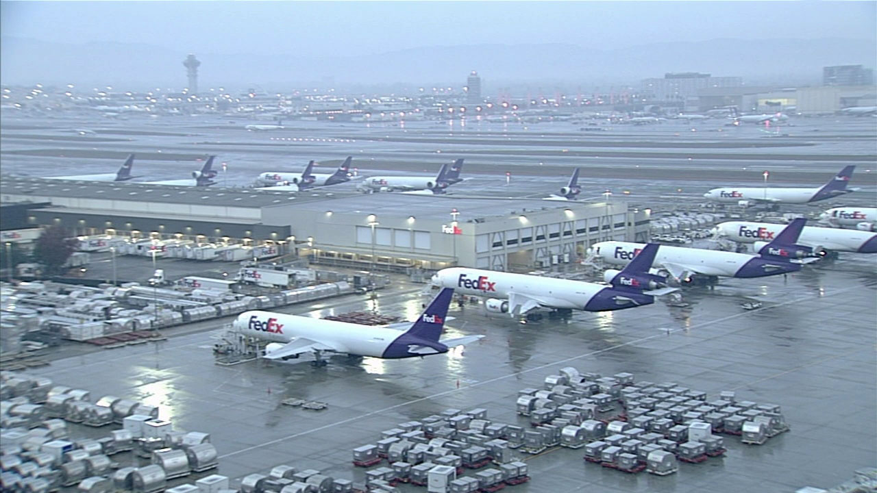 Heavy rain falls at LAX as a storm system moves through Southern California.