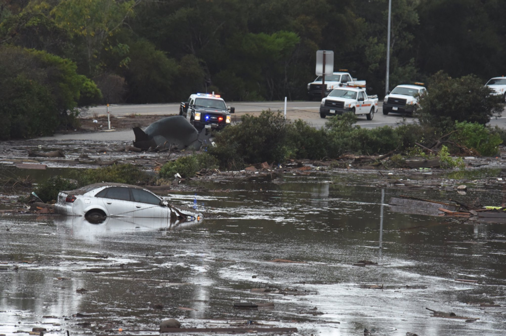 "<div class=""meta image-caption""><div class=""origin-logo origin-image none""><span>none</span></div><span class=""caption-text"">""The US 101 Freeway at the Olive Mill Road overpass flooded with runoff water from Montecito Creek."" (@EliasonMike/Twitter)</span></div>"