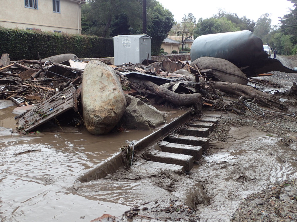 <div class='meta'><div class='origin-logo' data-origin='none'></div><span class='caption-text' data-credit='@EliasonMike/Twitter'>&#34;The main line of the Union Pacific Railroad through Montecito is blocked with mudflow and debris due to heavy rains.&#34;</span></div>