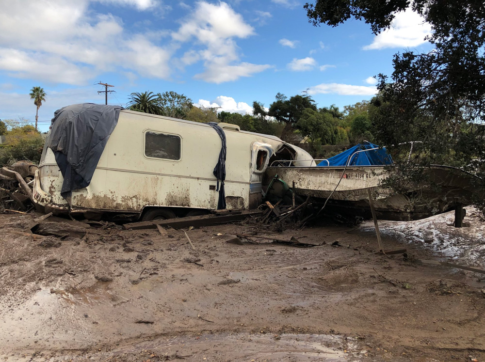 <div class='meta'><div class='origin-logo' data-origin='none'></div><span class='caption-text' data-credit='Santa Barbara County Fire'>&#34;Damaged vehicles that were pushed by mudflow and onto the US 101 Freeway from nearby residential area in Montecito.&#34;</span></div>