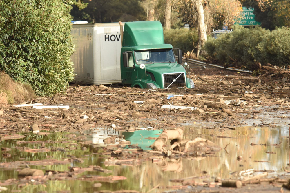<div class='meta'><div class='origin-logo' data-origin='none'></div><span class='caption-text' data-credit='Santa Barbara County Fire'>&#34;A semi-tractor trailer  sits stuck in mud on US Highway 101 northbound just south of the San Ysidro Road offramp in Montecito.&#34;</span></div>