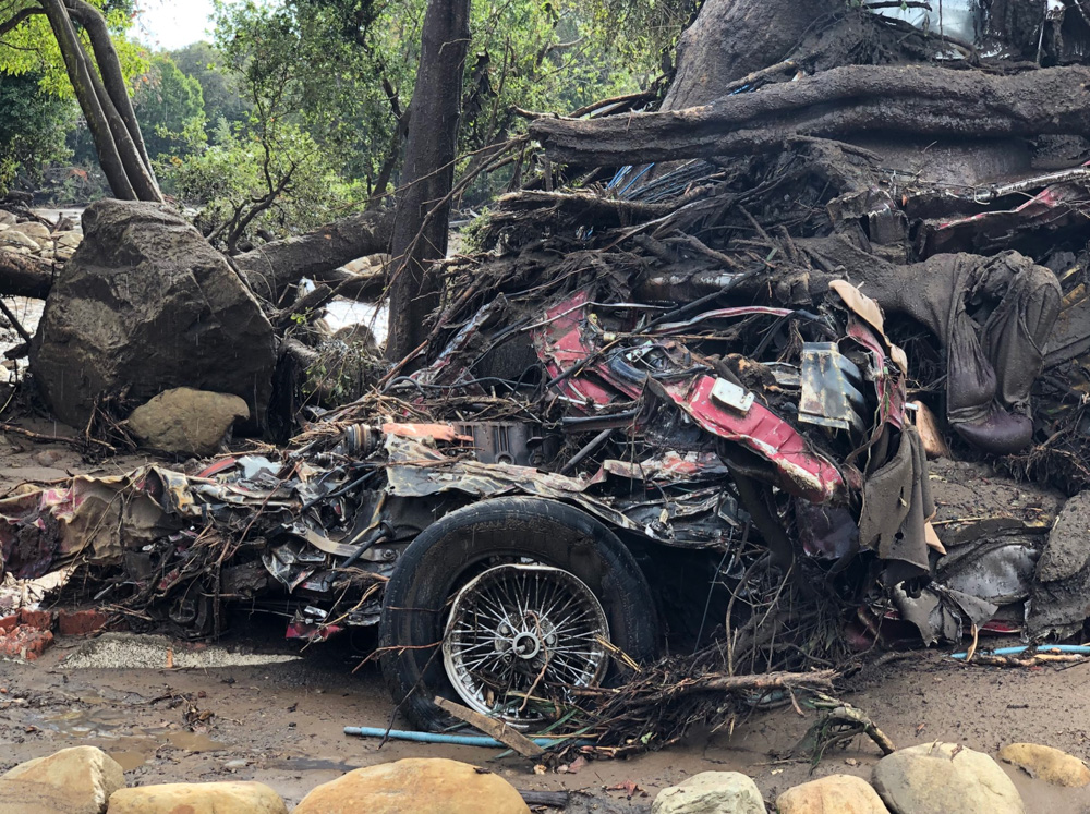 "<div class=""meta image-caption""><div class=""origin-logo origin-image none""><span>none</span></div><span class=""caption-text"">""A vehicle was wrapped and tangled around a tree by the force of deadly flood waters on Hot Springs Road in Montecito."" (Santa Barbara County Fire)</span></div>"