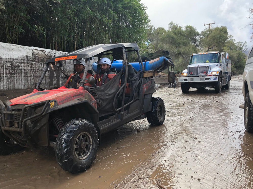 "<div class=""meta image-caption""><div class=""origin-logo origin-image none""><span>none</span></div><span class=""caption-text"">""SB Sheriff's Search and Rescue personnel along with Santa Barbara County Firefighters drive on Olive Mill Road in Montecito."" (Santa Barbara County Fire)</span></div>"