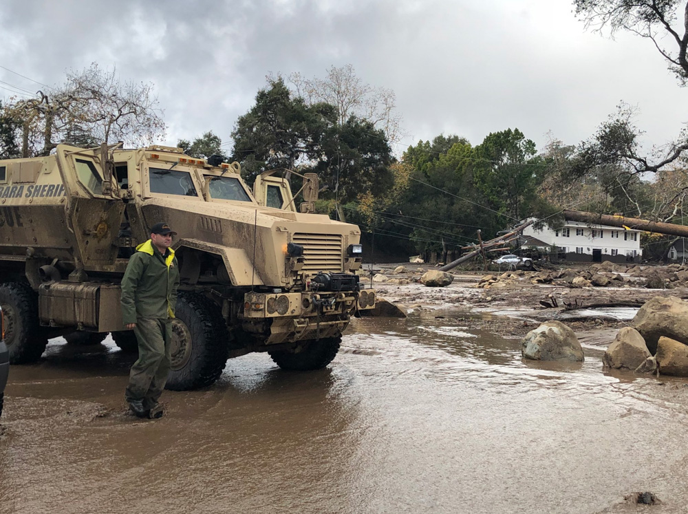 <div class='meta'><div class='origin-logo' data-origin='none'></div><span class='caption-text' data-credit='Santa Barbara County Fire'>&#34;A Santa Barbara County Sheriff's Rescue Vehicle is staged while trying to get past vehicles on Hot Springs Road in Montecito.&#34;</span></div>