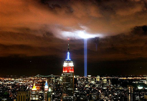 "<div class=""meta image-caption""><div class=""origin-logo origin-image none""><span>none</span></div><span class=""caption-text"">'Tribute in Light' illuminates the sky over Manhattan, Monday, Sept. 11, 2006 in New York, marking the fifth anniversary of the Sept. 11 terror attacks. (AP Photo/ DIMA GAVRYSH)</span></div>"