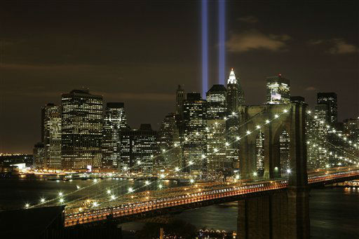 "<div class=""meta image-caption""><div class=""origin-logo origin-image none""><span>none</span></div><span class=""caption-text"">The Tribute in Light illuminates the sky over the Brooklyn Bridge and lower Manhattan Thursday, Sept. 11, 2008 in New York. (AP Photo/ Mark Lennihan)</span></div>"