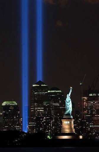 "<div class=""meta image-caption""><div class=""origin-logo origin-image none""><span>none</span></div><span class=""caption-text"">In this Sept. 11, 2004 file photo, the Tribute in Light shines over the Manhattan skyline and the Statue of Liberty in New York. (AP Photo/ Brian Branch-Price)</span></div>"
