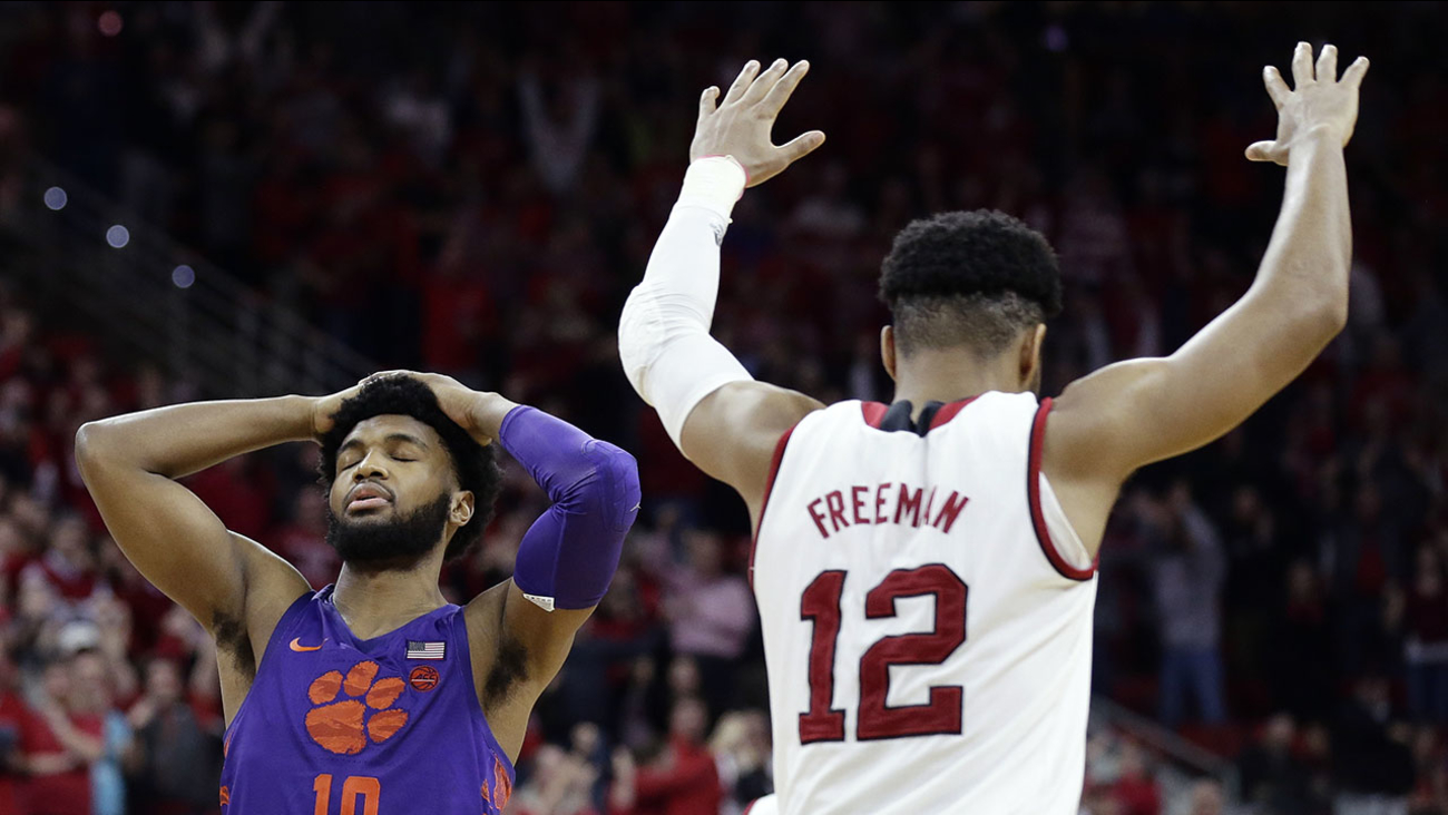 Clemson's Gabe DeVoe reacts after missing a free throw that would have tied the game with less than a second to play as NC State's Allerik Freeman celebrates Thursday night in Raleigh.