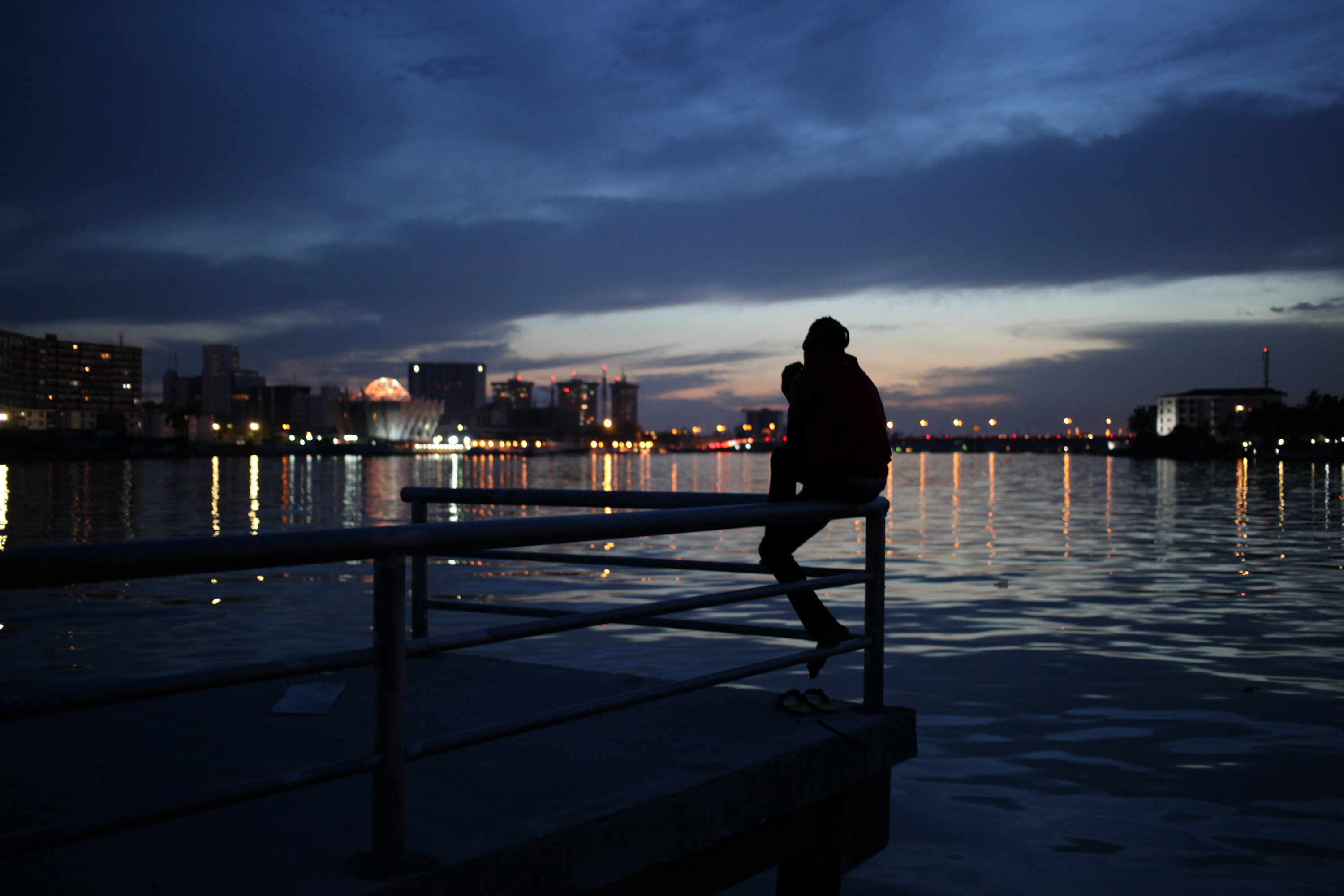 "<div class=""meta image-caption""><div class=""origin-logo origin-image ap""><span>AP</span></div><span class=""caption-text"">A man watches the sunset over the Lagos Lagoon in Lagos, Nigeria. (AP)</span></div>"