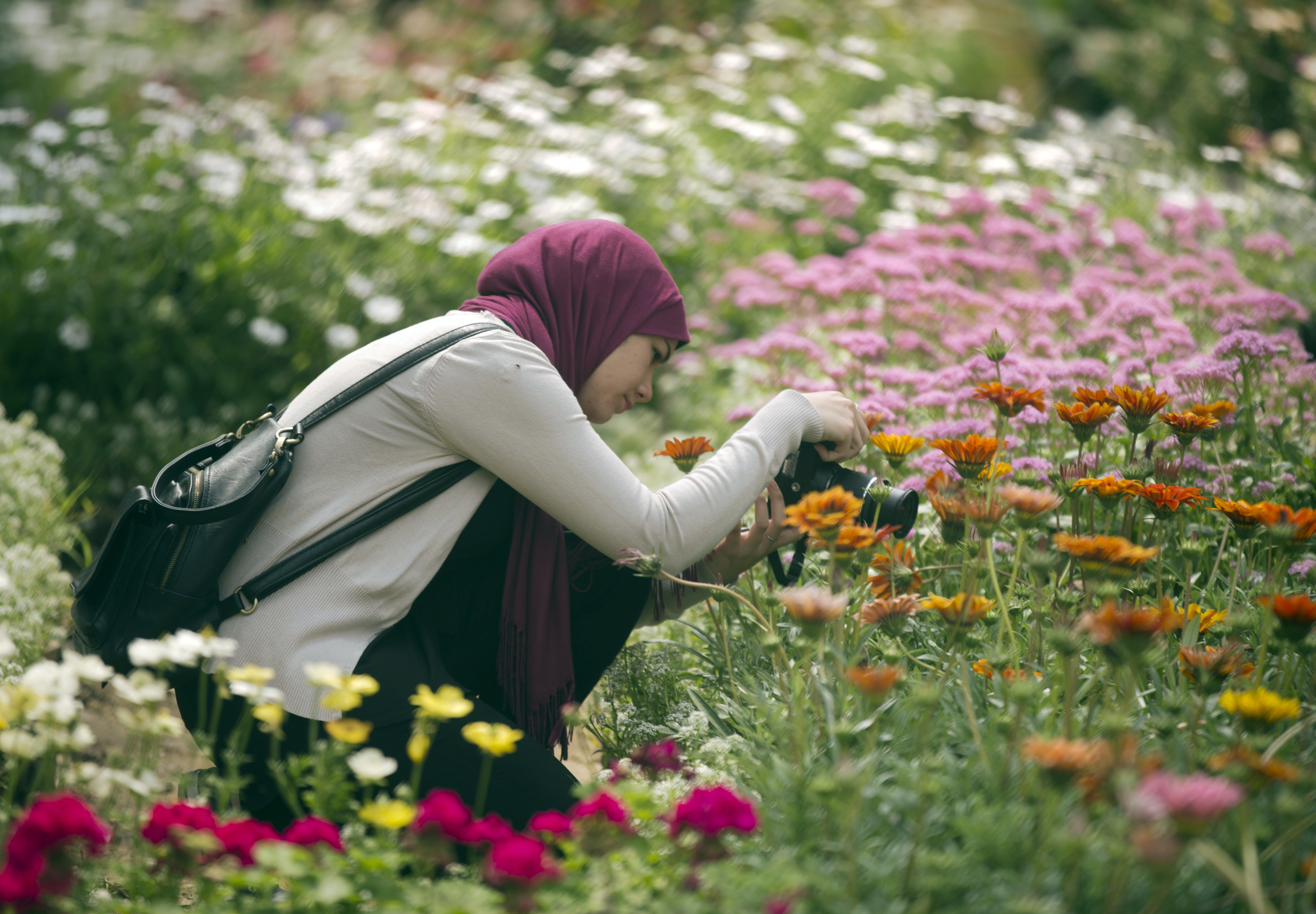 "<div class=""meta image-caption""><div class=""origin-logo origin-image ap""><span>AP</span></div><span class=""caption-text"">A visitor takes pictures at the Spring Flowers exhibition at the Orman Garden, in Cairo, Egypt. (AP)</span></div>"