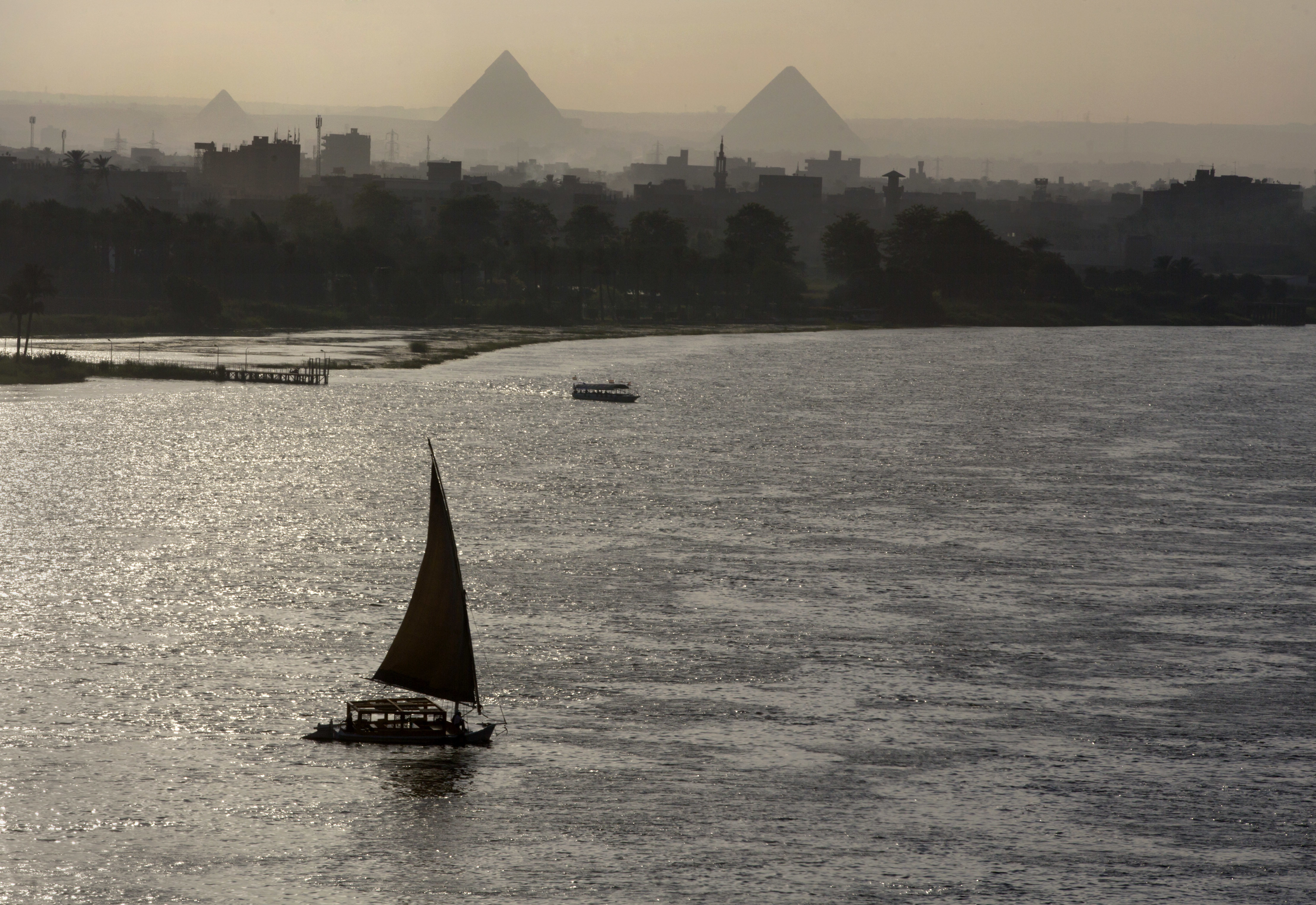 "<div class=""meta image-caption""><div class=""origin-logo origin-image ap""><span>AP</span></div><span class=""caption-text"">Holiday makers take a boat tour on the Nile River past the Great Pyramids, in Cairo, Egypt. (AP)</span></div>"