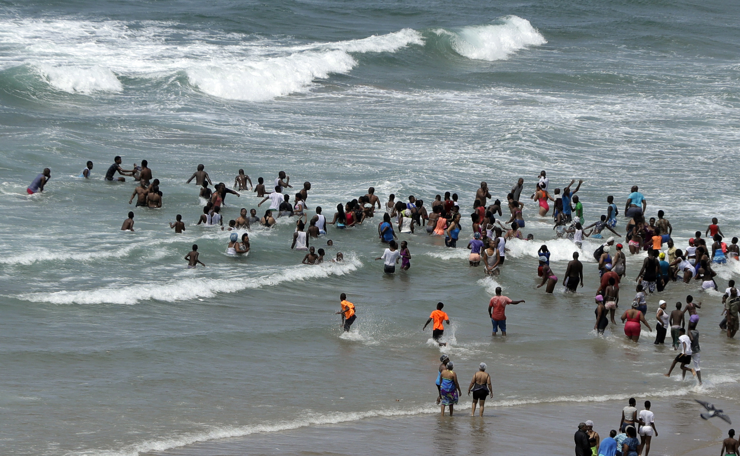"<div class=""meta image-caption""><div class=""origin-logo origin-image ap""><span>AP</span></div><span class=""caption-text"">Locals and tourists swim and play on the beach in Durban, South Africa. (AP)</span></div>"