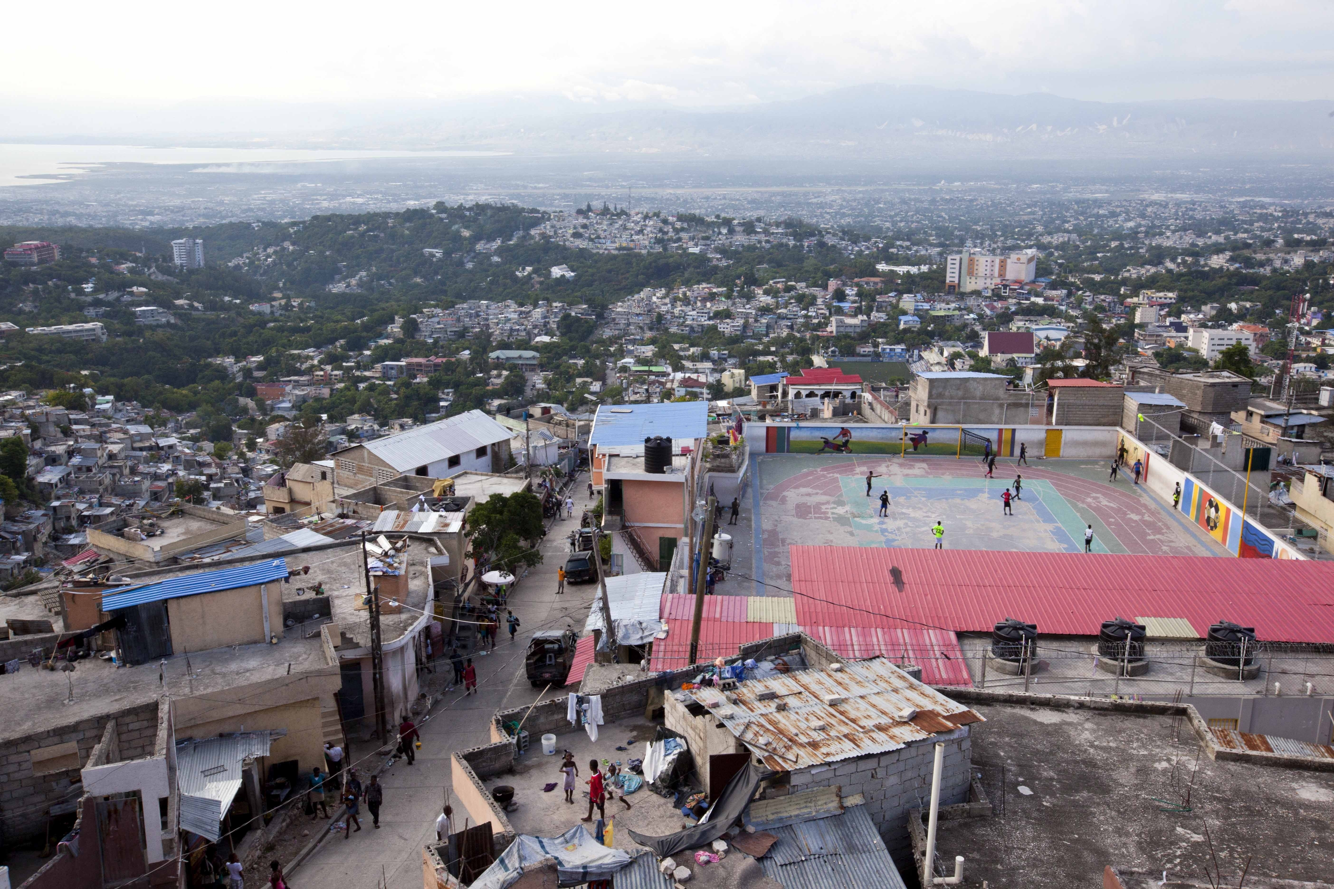 "<div class=""meta image-caption""><div class=""origin-logo origin-image none""><span>none</span></div><span class=""caption-text"">Residents play soccer on top of a hillside neighborhood in the Jalousie district of Port-au-Prince, Haiti. (AP)</span></div>"