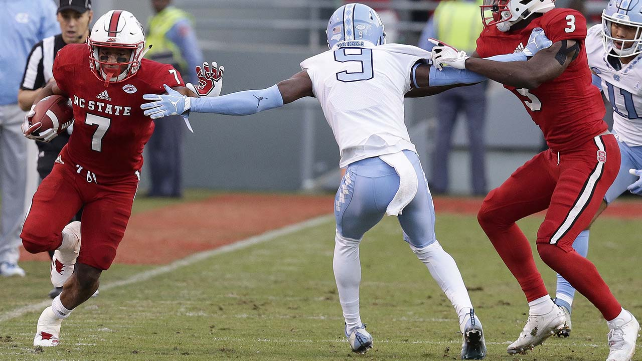 NC State's Nyheim Hines shredded the Tar Heels defense for 196 yards rushing and two touchdowns on Nov. 25, 2017.