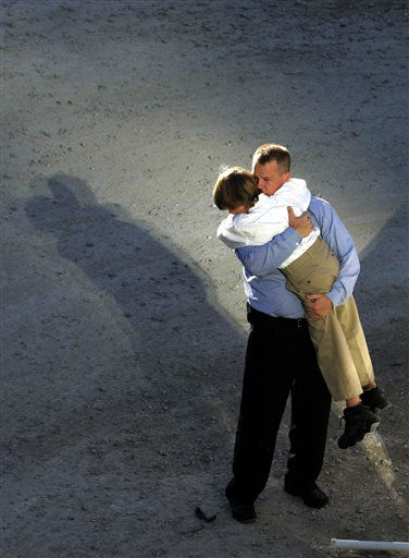 "<div class=""meta image-caption""><div class=""origin-logo origin-image none""><span>none</span></div><span class=""caption-text"">A man embraces a young boy during a ceremony Monday, Sept. 11, 2006 at the World Trade Center in New York marking the fifth anniversary of the terrorist attacks. (AP Photo/ MIKE SEGAR)</span></div>"