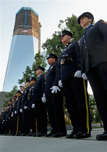 "<div class=""meta image-caption""><div class=""origin-logo origin-image none""><span>none</span></div><span class=""caption-text"">NYPD, FDNY and PAPD line up at one of the entrances to 9/11 Memorial Plaza at the World Trade Center site before the 10th anniversary ceremony in 2011. (AP Photo/ Chip Somodevilla)</span></div>"