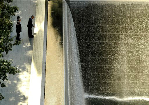 "<div class=""meta image-caption""><div class=""origin-logo origin-image none""><span>none</span></div><span class=""caption-text"">President Barack Obama runs his hand along the names on the Sept. 11 memorial as former President George W. Bush, Laura Bush and Michelle Obama look in 2011. (AP Photo/ Timothy A. Clary)</span></div>"