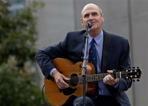 "<div class=""meta image-caption""><div class=""origin-logo origin-image none""><span>none</span></div><span class=""caption-text"">James Taylor performs during a ceremony to mark the 10th anniversary of the Sept. 11 attacks in 2011. (AP Photo/ Allan Tannenbaum)</span></div>"