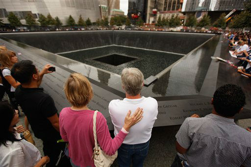 "<div class=""meta image-caption""><div class=""origin-logo origin-image none""><span>none</span></div><span class=""caption-text"">Family members gather at the edge of the north reflecting pool of the Sept. 11 memorial during 10th anniversary ceremonies at the site in 2011. (AP Photo/ Chip Somodevilla)</span></div>"