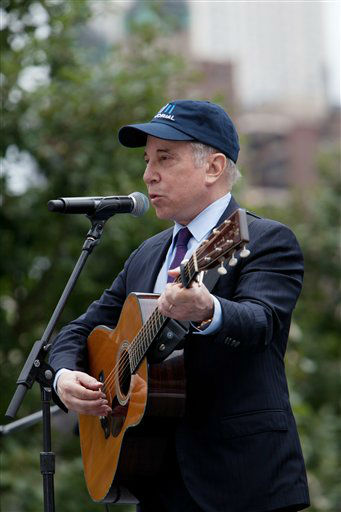 "<div class=""meta image-caption""><div class=""origin-logo origin-image none""><span>none</span></div><span class=""caption-text"">Paul Simon performs during a ceremony to mark the 10th anniversary of the Sept. 11 attacks in 2011. (AP Photo/ Allan Tannenbaum)</span></div>"