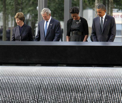 "<div class=""meta image-caption""><div class=""origin-logo origin-image none""><span>none</span></div><span class=""caption-text"">President Barack Obama, first lady Michelle Obama, former President George W. Bush and former first lady Laura Bush observe a moment of silence in 2011. (AP Photo/ Mary Altaffer)</span></div>"