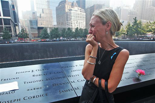 "<div class=""meta image-caption""><div class=""origin-logo origin-image none""><span>none</span></div><span class=""caption-text"">Carrie Bergonia of Pennsylvania looks over the name of her fiancé, firefighter Joseph Ogren, at the 9/11 Memorial during ceremonies in 2013. (AP Photo/ Chris Pedota)</span></div>"