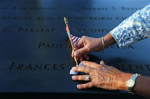 "<div class=""meta image-caption""><div class=""origin-logo origin-image none""><span>none</span></div><span class=""caption-text"">Judy Parisio places a small U.S. flag on the engraved name of her niece, Frances Ann Cilente, who worked and died at the World Trade Center, in 2012 (AP Photo/ Chang W. Lee)</span></div>"