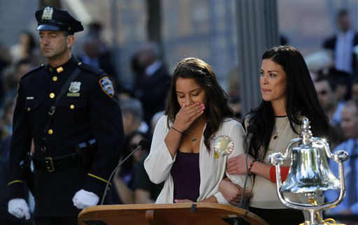 "<div class=""meta image-caption""><div class=""origin-logo origin-image none""><span>none</span></div><span class=""caption-text"">A woman becomes emotional after reading the name of her father at the ceremony marking the 11th anniversary in 2012. (AP Photo/ Jason DeCrow)</span></div>"