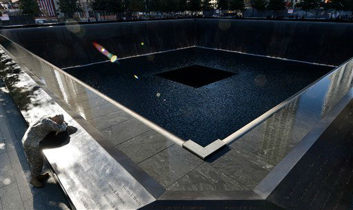 "<div class=""meta image-caption""><div class=""origin-logo origin-image none""><span>none</span></div><span class=""caption-text"">Scott Willens, who joined the United States Army three days after 9/11, pauses by the South Pool in 2012, (AP Photo/ Justin Lane)</span></div>"