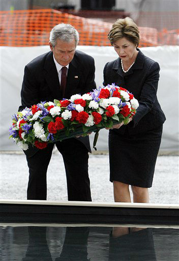 "<div class=""meta image-caption""><div class=""origin-logo origin-image none""><span>none</span></div><span class=""caption-text"">President Bush and first lady Laura Bush lay a memorial wreath in a pool of water at ground zero Sunday, Sept. 10, 2006, marking the 5th anniversary. (AP Photo/ SETH WENIG)</span></div>"