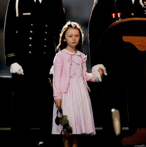 "<div class=""meta image-caption""><div class=""origin-logo origin-image none""><span>none</span></div><span class=""caption-text"">Patricia Smith, daughter of police officer Moira Smith, holds the hand of father James Smith on stage during the fifth anniversary in 2006. (AP Photo/ SPENCER PLATT)</span></div>"