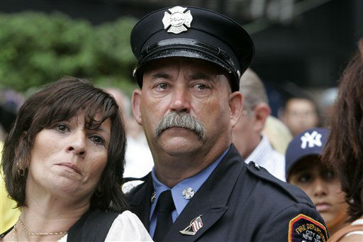 "<div class=""meta image-caption""><div class=""origin-logo origin-image none""><span>none</span></div><span class=""caption-text"">Robin Ferreira and James Sorokac, with the FDNY, join other mourners during a commemoration ceremony on Tuesday, Sept. 11, 2007 on the sixth anniversary. (AP Photo/ Frank Franklin II)</span></div>"
