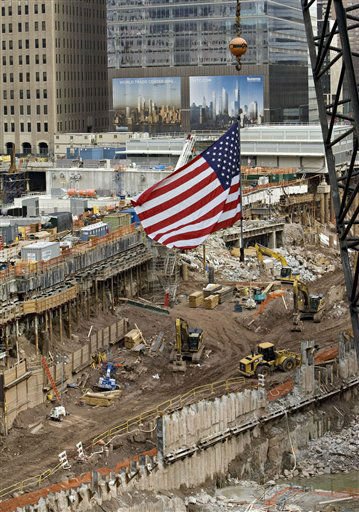 "<div class=""meta image-caption""><div class=""origin-logo origin-image none""><span>none</span></div><span class=""caption-text"">An American flag flies from a crane over the World Trade Center site during the seventh annual ceremony in 2008. (AP Photo/ DANIEL ACKER)</span></div>"